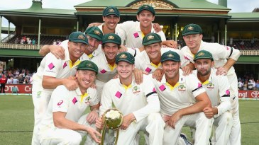 The Australian team with the Border-Gavaskar Trophy after the draw at the SCG