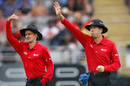 Taxi! Billy Bowden and Nigel Llong call for the covers, New Zealand v Sri Lanka, 3rd ODI, Auckland, January 17, 2015