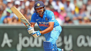 Rohit Sharma guides the ball on to the leg side