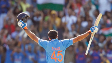 Rohit Sharma acknowledges the crowd after reaching his hundred