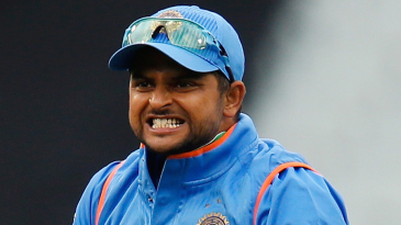 Suresh Raina celebrates after taking a catch