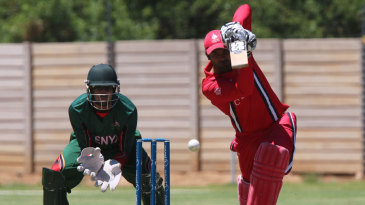 Navneet Dhaliwal scored 93 to power Canada to a competitive total