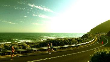 Competitors run along the Great Ocean Road