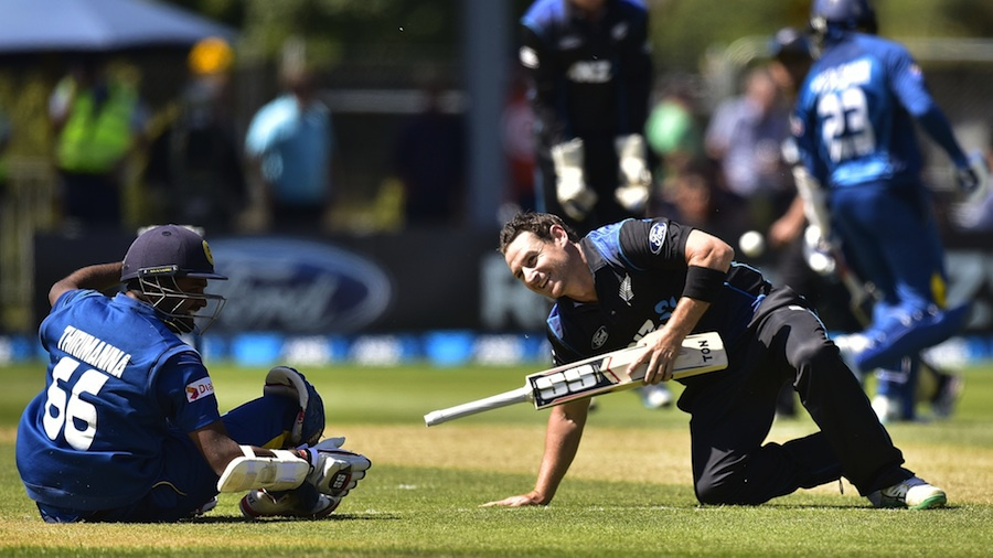 Lahiru Thirimanne and Nathan McCullum smile after a collision