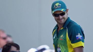 Shane Watson watches the game from the sidelines