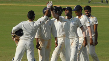 Tamil Nadu players celebrate their innings win over Mumbai