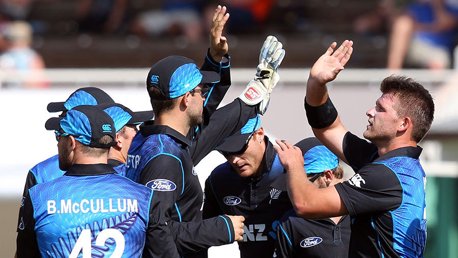 Corey Anderson celebrates the wicket of Dimuth Karunaratne with his team-mates