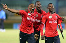 Dwayne Bravo, Kevon Cooper and Jason Mohammed celebrate T&T's win, Trinidad & Tobago v Guyana, Nagico Super50 final, Trinidad, January 25, 2014