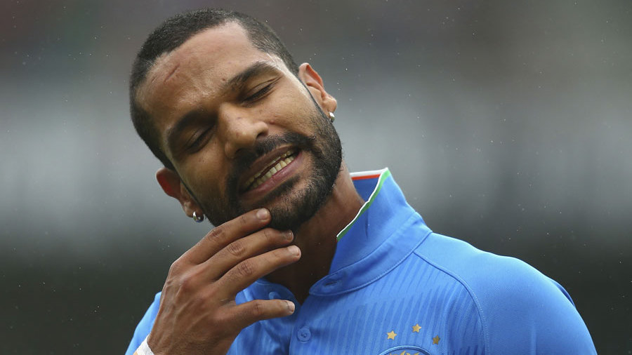 A disappointed Shikhar Dhawan walks back for another low score