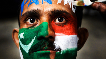 A fan with his face painted in the colours of India and Pakistan