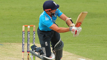 James Taylor gets off his toes to play the ball through the leg side