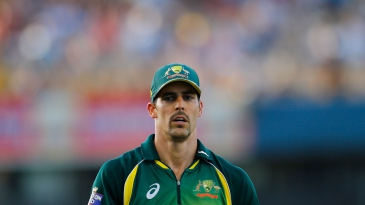 Mitchell Johnson stands in the field