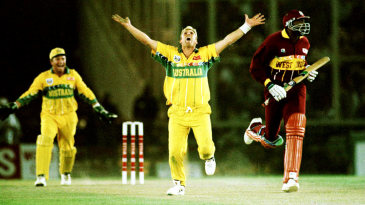Shane Warne celebrates the wicket of Ian Bishop