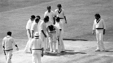 The Australian players gather around Sunil Wettimuny after he was struck in the chest by a Jeff Thomson delivery