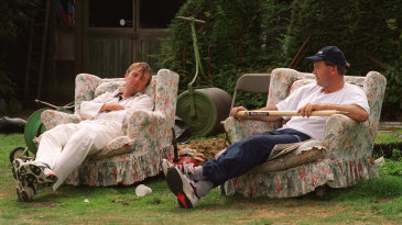 Phil Tufnell and Mike Roseberry relax on armchairs in the sidelines of a county game in Southgate
