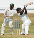 Anthony Bramble flays the ball through the offside, Jamaica v Guyana, 1st day, Regional 4 Day Tournament, Jamaica, February 6, 2015