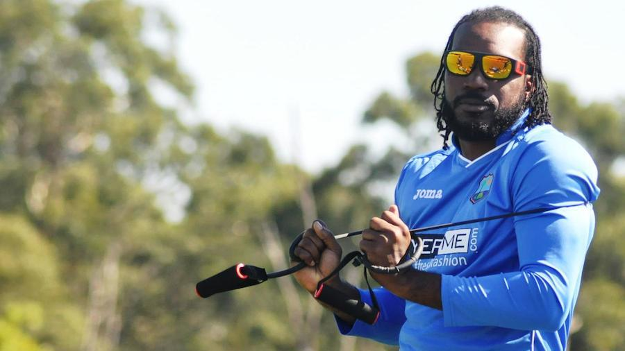Tangled: Chris Gayle stretches during a training session