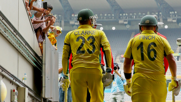 Michael Clarke walks out to open the innings with Aaron Finch