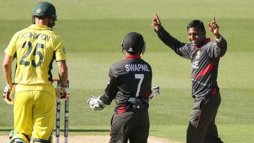 Krishna Chandran celebrates taking a wicket