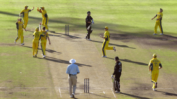 Shane Bond is caught and bowled by Brett Lee