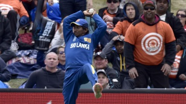 Jeevan Mendis takes a sharp catch in the deep to dismiss Brendon McCullum