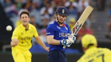 Eoin Morgan looks back to see Brad Haddin about to pouch his edge
