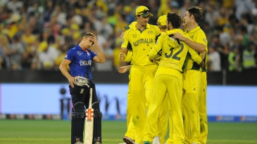 A disappointed James Taylor watches Australia celebrate