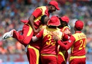 Zimbabwe players mob Tafadzwa Kamungozi,  South Africa v Zimbabwe, Group B, World Cup 2015, Hamilton, February 15, 2015