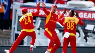 Craig Ervine celebrates after pulling off a hokey-pokey catch to dismiss AB de Villiers