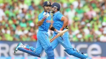 Virat Kohli exults after bringing up his ton