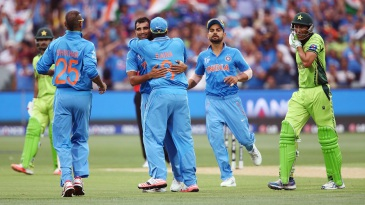 Mohammed Shami is congratulated after he removed Younis Khan