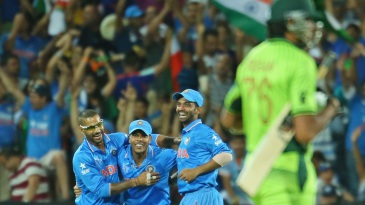 The India players rejoice after clinching victory against Pakistan