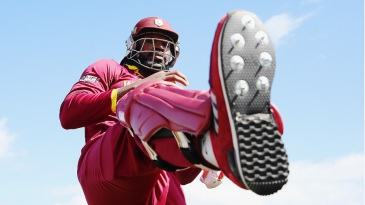 Chris Gayle limbers up before going out to bat