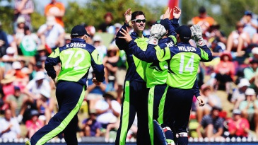 George Dockrell is mobbed by team-mates after he had Marlon Samuels lbw