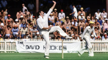 Dennis Lillee bowls during a Supertest against West Indies