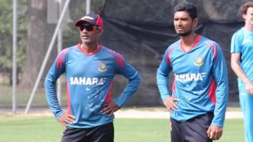 Mahmudullah and Ruwan Kalpage watch the Bangladesh players practice