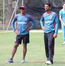Mahmudullah and Ruwan Kalpage watch the Bangladesh players practice, World Cup 2015, Canberra, February 16, 2015