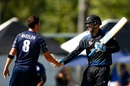 Daniel Vettori shakes hands with Iain Wardlaw after hitting the winning runs, New Zealand v Scotland, World Cup 2015, Group A, Dunedin, February 17, 2015