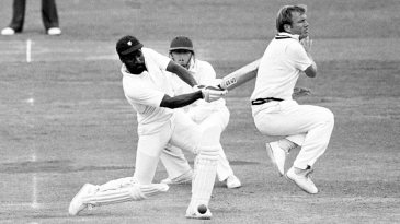 Middlesex's Clive Radley leaps out of the way as Viv Richards cuts the ball square