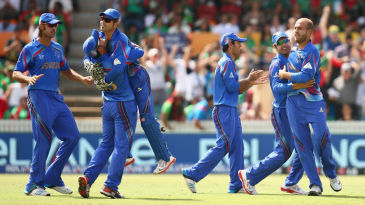 Afghanistan celebrate the wicket of Tamim Iqbal