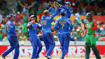 Afghanistan players celebrate getting Anamul Haque even as he reviews