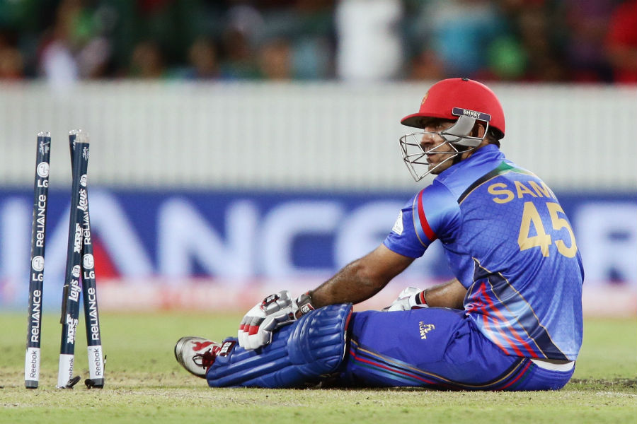 Afghanistan managed to make a slow recovery with a 62-run fourth-wicket stand which ended with Samiullah Shenwari's run out