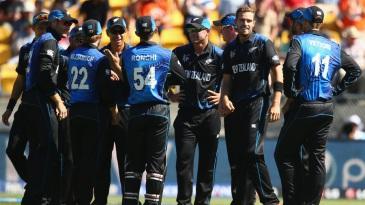 New Zealand players get together after James Taylor's dismissal for 0
