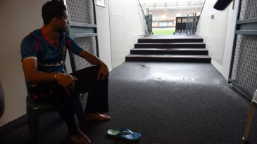 Mashrafe Mortaza looks at the ground as rain prevented practice