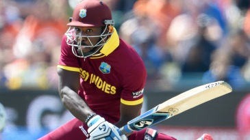 Andre Russell plays an outrageous shot during his 13-ball 42