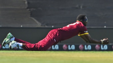Sulieman Benn takes a diving catch to get rid of Sohaib Maqsood