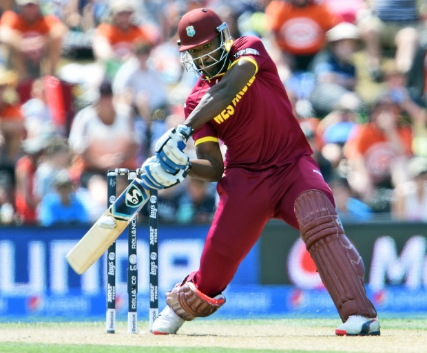 Andre Russell prepares to flay one through the off side