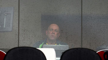 Darren Lehmann watches from the dressing room as the rain shows no signs of stopping