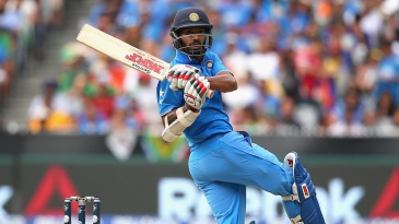 Shikhar Dhawan swivels and pulls