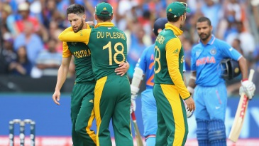 Wayne Parnell is congratulated by Faf du Plessis on the wicket of Shikhar Dhawan